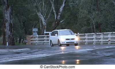 Road with car and trees - A full shot of a car driving on...
