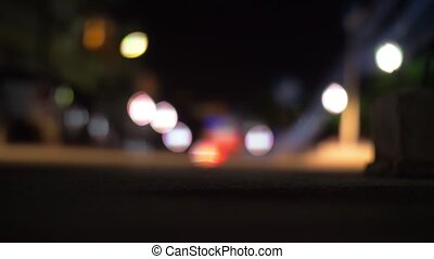 Road with car driving at night, blur