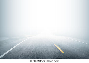 Road with fog in the morning