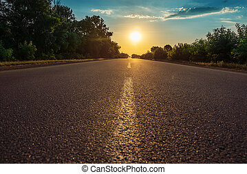 road with line closeup in sunset