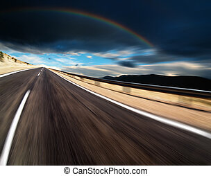 Road in desert with motion blur and storm clouds