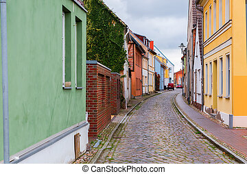 cobblestone road with old buildings in Wolgast, Mecklenburg-West Pomerania, Germany