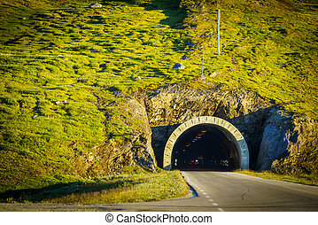 Road with tunnel in mountains Norway