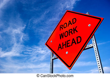 Road Work Ahead Sign - Image of a bright orange road work...