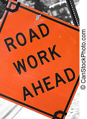 Road Work Ahead - An orange road sign that reads ROAD WORK...