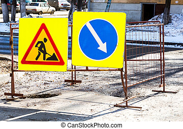 Road work and detour signs on the city road