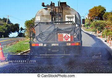 Road work - CABLE BAY, NZ - APR 01 2014:Tar truck vehicle ...