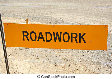 Road Work - yellow road work sign with gravel background