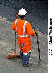 Road worker during asphalt work repair