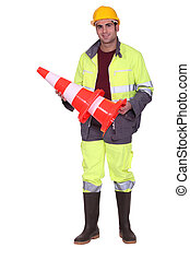 road worker holding a traffic cone