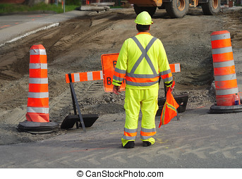 road worker man wearing fluorescent yellow safety color street repair under construction