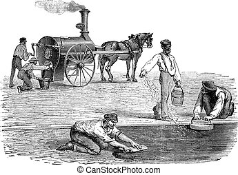 Road workers making pavement with the help of steam engine...