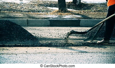 road workers perform road repairs