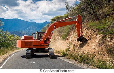 Excavator repair the road. - Road works. Excavator repair ...