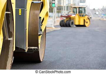 Road works - Road rollers vibration machines compacting...
