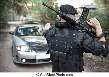 Roadblock - Warrior with the M4 rifle is stopping the car on...