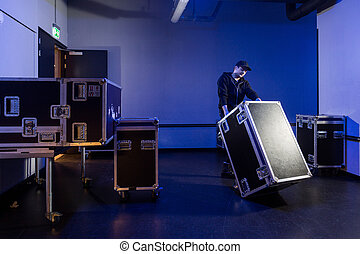 Roadie tipping over a flightcase - Roadie tipping a...