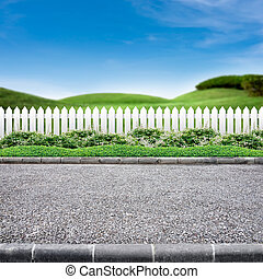 Roadside and white fence - Roadside view and white fence on...