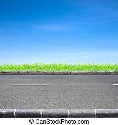 Roadside grass and blue sky - Roadside view and green grass ...
