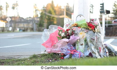 Roadside Memorial Marker - Flowers at a busy intersection ...