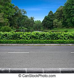 Roadside view of beautiful park on blue sky
