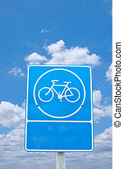 roadsign bicycle under cloudy sky