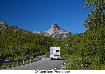 Camping car on roadtrip across Lofoten islands in Norway