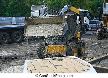 roadwork on laying of paving slabs