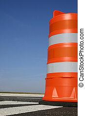 Roadwork - One orange construction barrel signaling roadwork...