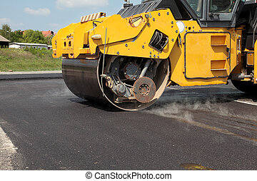 Roadwork - Road roller at a road construction site