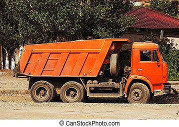 roadwork truck - A right view of orange roadwork truck.