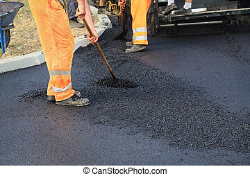 Roadwork - Workers making asphalt with shovels at road ...