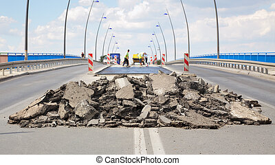 Roadworks - Damaged asphalt road and bridge in ...