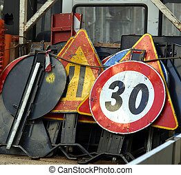 Road works signs and traffic cones on a lorry
