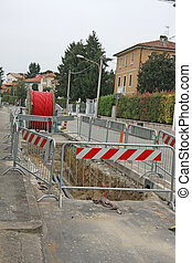 roadworks with a huge excavation for the laying of high voltage power cable