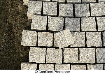 cobblestones - roadworks with cobblestones at a building ...