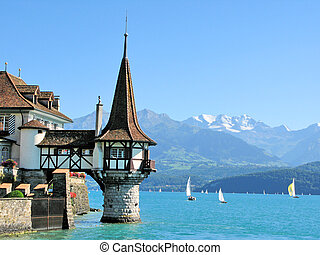 Roaman tower of the famous Oberfofen castle at the lake...