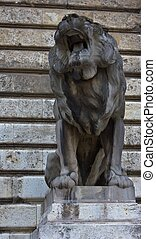 Roaring Lion - Roaring lion statue made of stone, low angle.