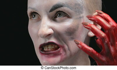 Roaring woman with make up - Footage of woman with horror...