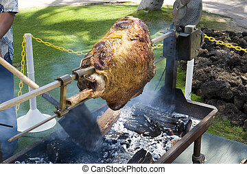 Meat roasting. All blur parts are result of movement, actually. Cook stirs coal pieces and turns meat at the same time.