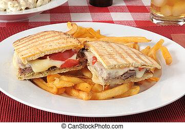 Roast beef and cheese panini on flatbread