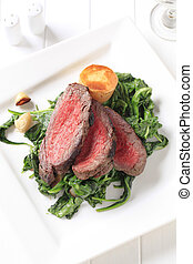 Roast beef and sauteed spinach - Slices of roast beef with...