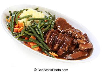 Roast Beef and Vegetables - Serving platter of sliced roast...