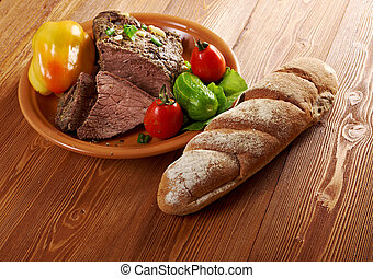 roast beef farm-style with vegetable and bread .farmhouse ...