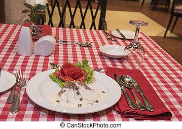 Roast beef in white sauce a la carte meal - Closeup of roast...