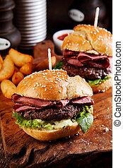Roast beef or pastrami burger on a sesame bun