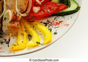 Roast chicken and yellow paprika