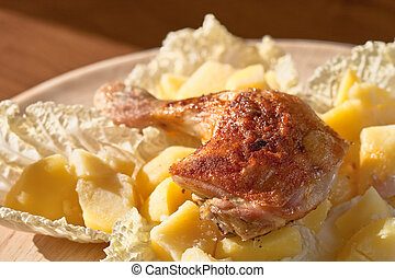 Roast chicken legs with potatoes