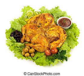 Roast chicken on a plate with salad, greens and tomato