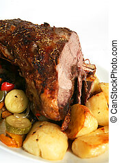 Herbed roast lamb with roast potatoes and stir-fried vegetables.